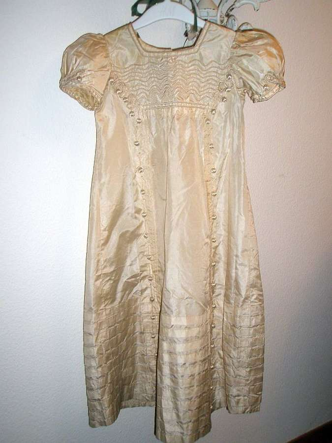 An exquisite Regency girls' cream silk dress, English ca. 1815